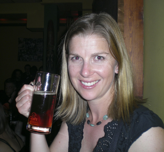 Lisa trying the red beer at Cafe Alvastron