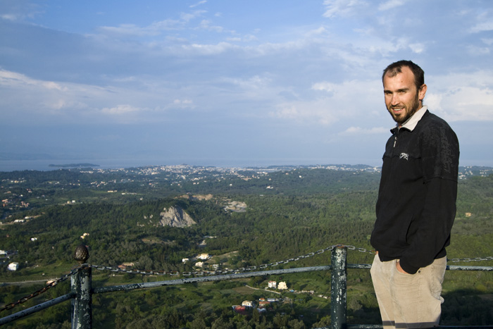 Sam at Kaiser's Throne with a view across Kerkyra to Kerkyra Town in the background