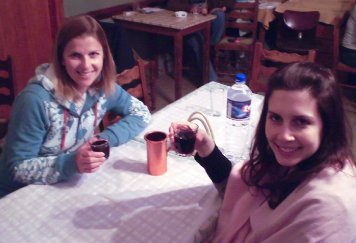 Sally and Lisa sampling some of Nick\'s home made wine at Koka Roka