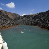 Swimming at the hot springs Nea Kameni