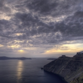 Sunset over Thirasia and Imerovigli: the quiet before the storm