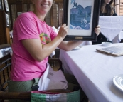 Lisa holding the menu at Cafe Batavia
