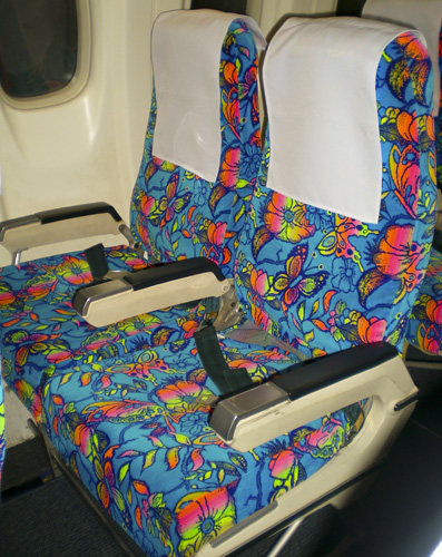 The colorful cabin decor on our flight from Hanoi to Luang Prabang