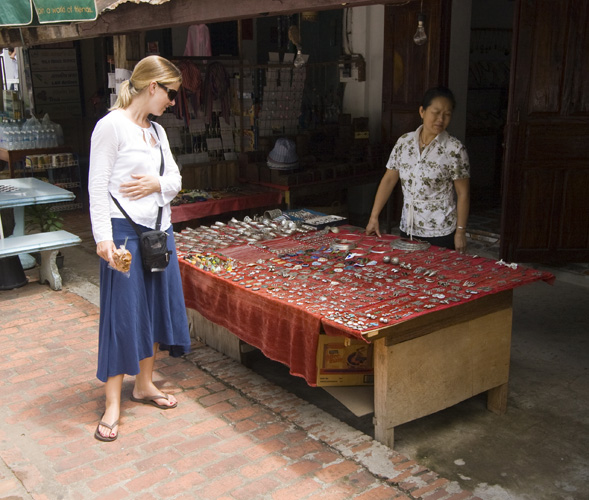 Lisa checking out the merchandise at a stall down Luang Prabang\'s main drag