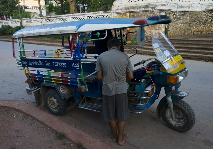 One of the more colorful tuk-tuks on the streets of Luang Prabang