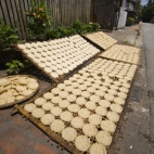 Rice cakes drying in the midday sun
