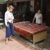 Lisa checking out the merchandise at a stall down Luang Prabang\'s main drag