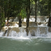Sam jumping off Tad Sae Waterfall