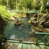 The spring-fed swimming hole outside Thamchang Cave