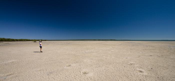 Lisa and the seemingly endless tidal mud flats near Pago