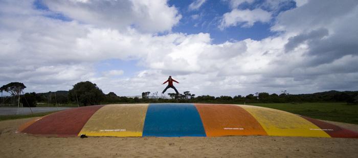 Lisa enjoying the air-filled trampoline at Ocean Beach