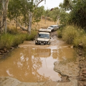 Lisa mastering one of the deeper water crossings on the road into Purnululu