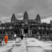 Monk standing at the entrance to Angkor Wat