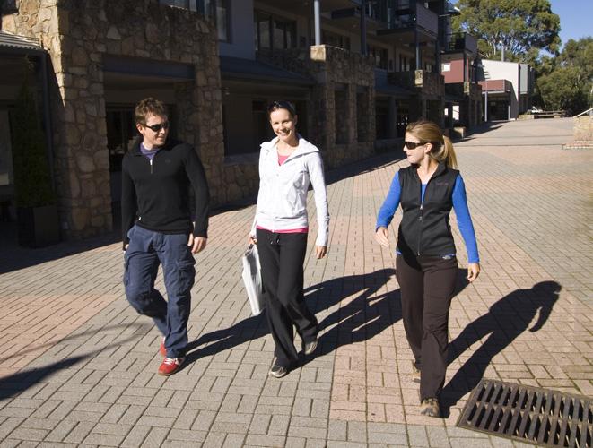 Will, Abi and Lisa walking through Thredbo village