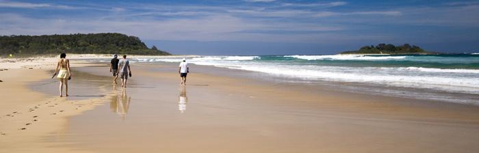Jacque, Sam, Jarrid and John walking along the beach at Lake Conjola