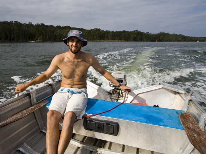 Sam piloting the dinghy around Lake Conjola
