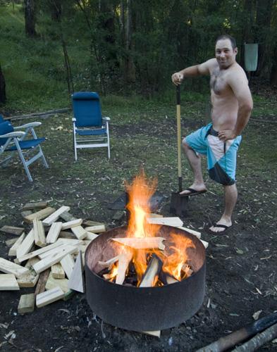 Jarrid tending to the fire at Euroka