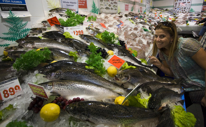 Lisa amongst a sea of fish at the Sydney Fish Market