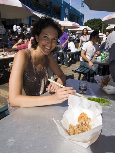 Jacque with some salt and pepper squid at the Sydney Fish Market