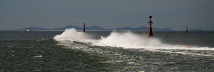 Powerboat water trails as they tear through the bay in Newcastle