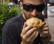 Sam sampling the fare from Pot Belly Pies in Maclean