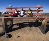 Judy, Todd and Lisa on an oversized bench in Broken Hill