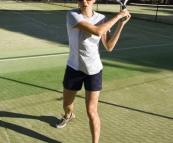 Abi demonstrating her swing at Thredbo