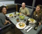 Jacque, Jarrid and Lisa with a lamb roast at Lake Conjola