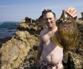 Jarrid with a monster Leatherjacket at Tomakin