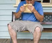 Jarrid enjoying a pie from Tilba Bakery