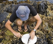 Sam cleaning a Sand Whiting at Aragunnu