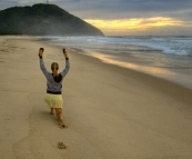 Lisa doing her morning exercises on the beach at sunrise in Hat Head National Park