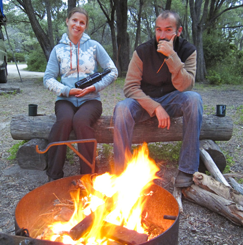 Sam and Lisa by the fire at Conto Campground