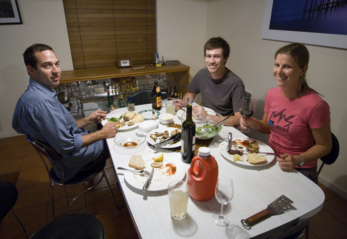 Cal, Sam and Lisa sitting down for dinner
