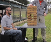 Sam and Sergey playing the huge Jenga at Bootleg Brewing Company