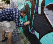 Working on the graffiti wall down the side of Mi-Life shoe store