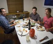 Cal, Sam and Lisa sitting down for dinner