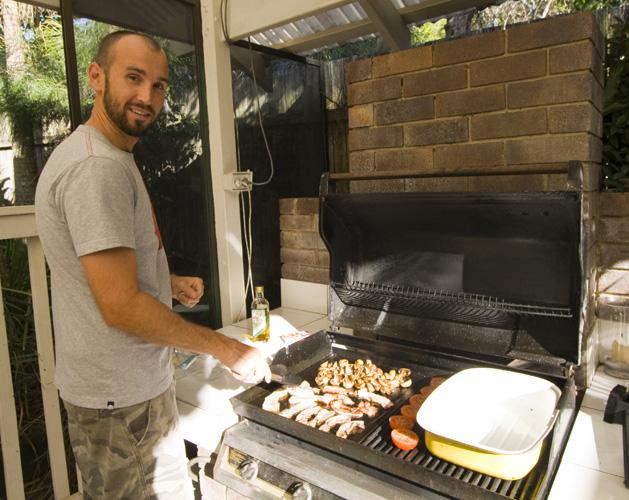 Sam cooking an Aussie breakfast