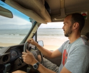 Sam driving along the sand on Fraser Island