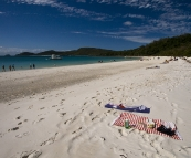 Relaxing on Whitehaven Beach on Whitsunday Island