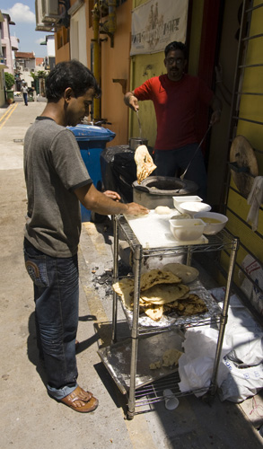 Making naan bread on the streets of Little India