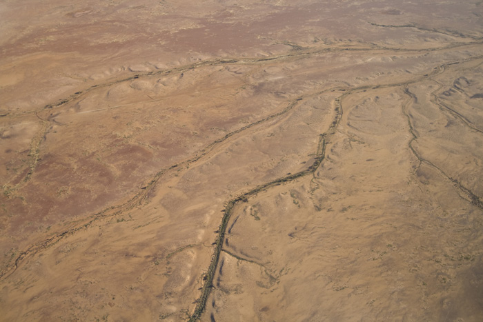 Dry creeks wind their way across The Outback between William Creek and Lake Eyre