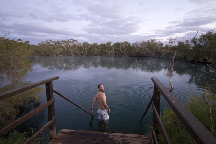 Sam taking a morning dip at Dalhousie Springs