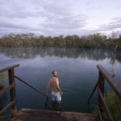 Sam taking a morning dip at Dalhousie Springs