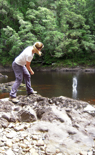 Lisa skimming rocks on the Frankland River