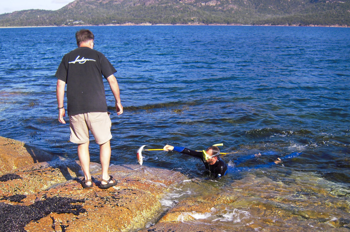 Greg helping Sam with a Yelloweye Mullet in Coles Bay