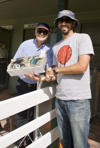 Sam and his raffle winnings at the King Island Races