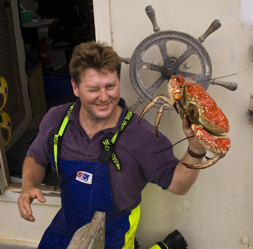 Russel holding a Giant Crab