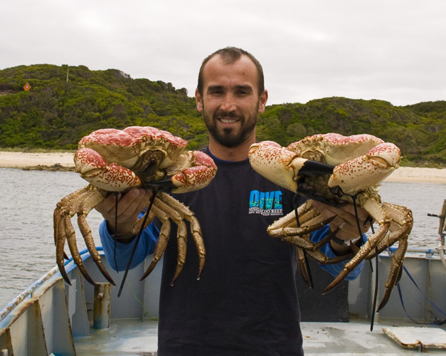 Sam holding  couple of Giant Crab