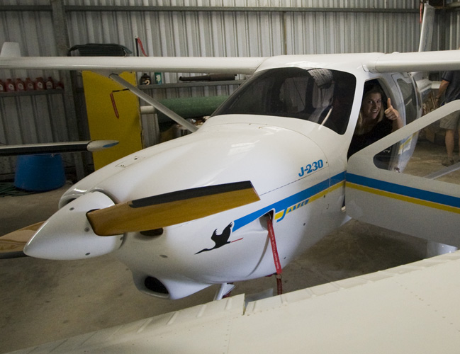Lisa in the cockpit of Grant\'s ultralight Jabiru plane